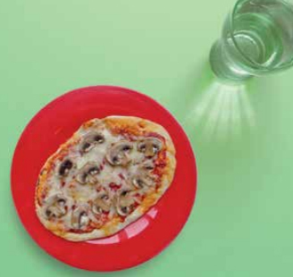 Image of a pizza made with a pitta bread with mushrooms on top.
