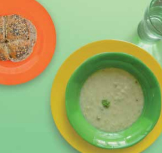 Vegetable soup and a bread roll