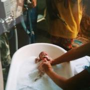Sophie being bathed for the first time